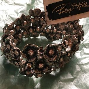 Silver flower bracelet with clear crystals. New